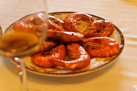 Plate of prawns with his glass to celebrate the holiday