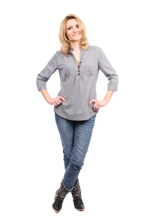 Full length portrait of a caucasian blond woman isolated on white