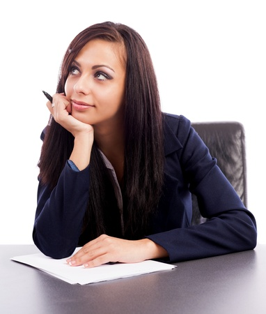Closeup portrait of a latin businesswoman thinking while sitting at desk isolated on white background