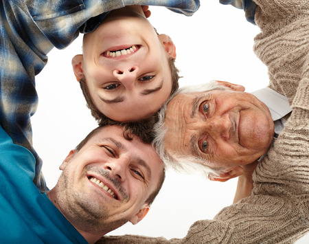 Three men generations looking down into camera