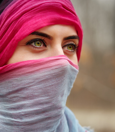 Closeup portrait of a muslim woman with beautiful green eyes