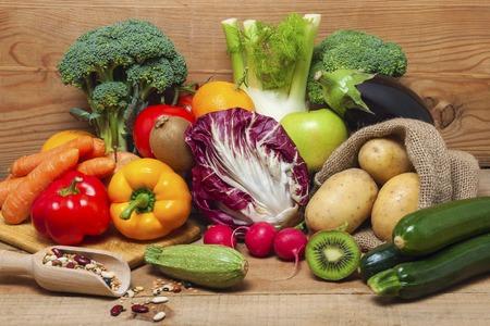 Foto für Colorful fruits, vegetables and legumes on wood background - Lizenzfreies Bild