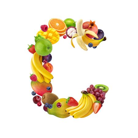 Foto de Letter C made of different fruits and berries, fruit alphabet isolated on white background - Imagen libre de derechos