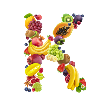 Foto de Letter K made of different fruits and berries, fruit font isolated on white background with clipping path, healthy alphabet - Imagen libre de derechos