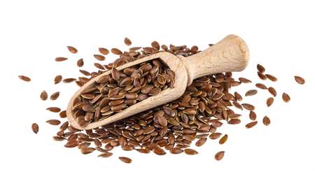 Photo pour Pile of flax seeds isolated on white background, close-up of flaxseed in wooden scoop - image libre de droit
