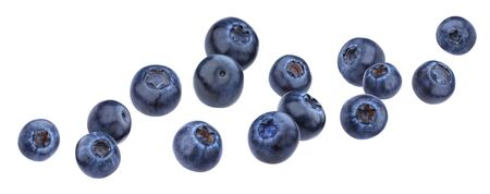 Foto de Falling blueberry isolated on white background with clipping path - Imagen libre de derechos