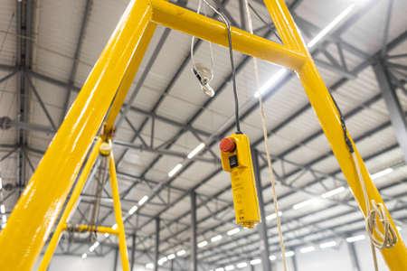 Photo pour Close up red button. Swivel electric crane hook for overhead crane in the workshop or factory - image libre de droit