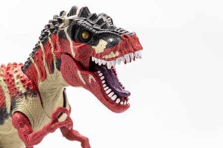 Photo pour close-up of a plastic tyranosaurus colorfull figurine isolated on a white background - image libre de droit