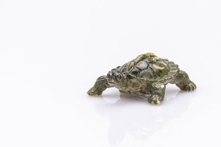 Photo pour close-up of an orange plastic tortoise isolated on a white background - image libre de droit