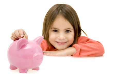little girl with piggy bank isolated on white background
