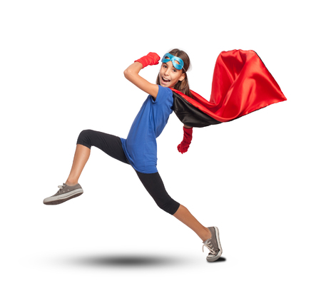 little girl wearing a superhero costume on white background