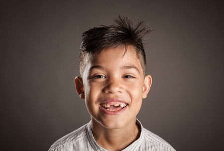 Photo for portrait of happy kid smiling on a grey background - Royalty Free Image