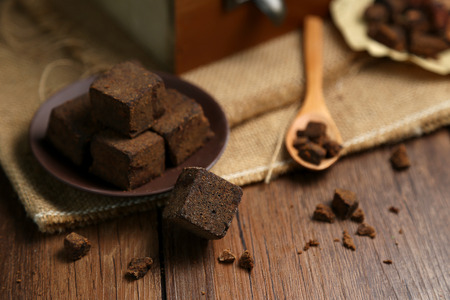 Photo for Brown sugar chunks in wooden boxes and plates - Royalty Free Image