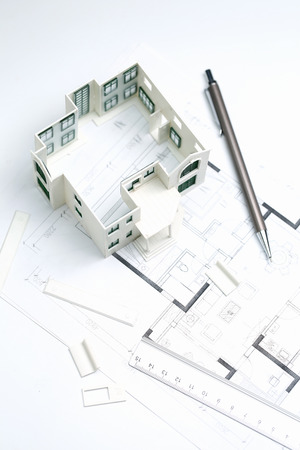 Photo pour house model,blueprint,pencil and ruler on white background - image libre de droit