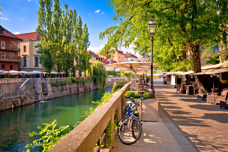Ljubljana green riverfront promenade walkway summer view, capital of Slovenia