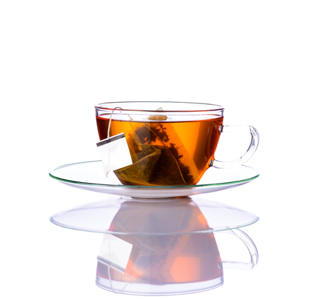 One glass Tea cup with tea-bag isolated on white background