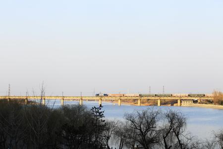Train passing by a bridge