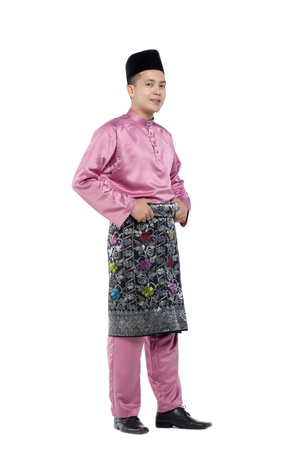 Photo for Portrait of young and handsome asian man with traditional clothing during hari raya over white background - Royalty Free Image