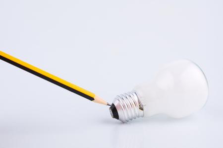 Foto de pencil and bulb over white background for creative ideas concept - Imagen libre de derechos