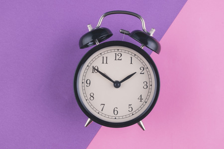 Photo pour Time management concept, alarm clock on purple background. copy space for text - image libre de droit