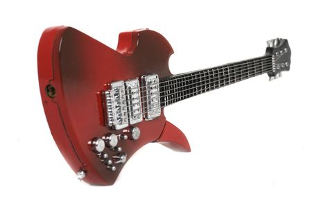 Isolated red electric guitar over white background