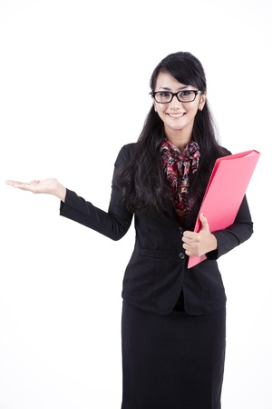 Asian business woman showing copyspace. Presentation. Isolated over white background.