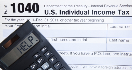 Electronic Tax form 1040 with the help word on calculator
