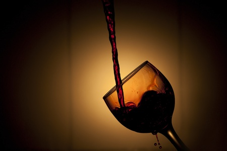 Beautiful image of the Pouring red Wine