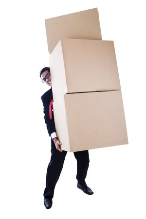 A businessman carrying heavy boxes shot in studio isolated on white background