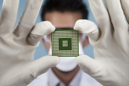 A scientist showing of a closeup computer chip