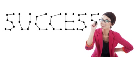 Businesswoman connecting the dots making the word success
