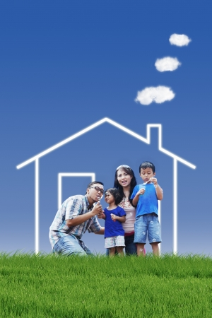 Photo for Portrait of asian family with dream house playing bubble outdoor - Royalty Free Image
