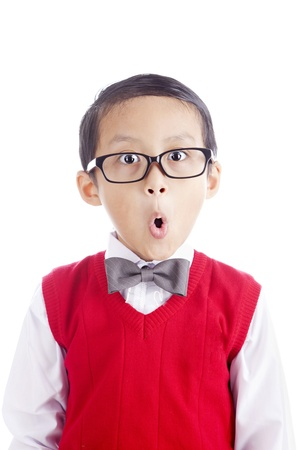 Portrait of asian schoolboy with funny expression face. shot in studio isolated on whiteの写真素材
