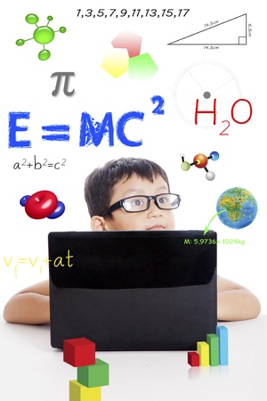 Portrait of smart boy with physics formula and laptop computer
