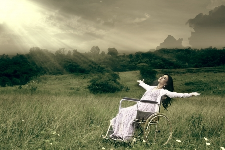 Asian woman in wheelchair embracing freedom outdoor