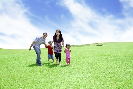 Foto de Happy family: Father, Mother, and their children. Shot outdoor in summer day  - Imagen libre de derechos