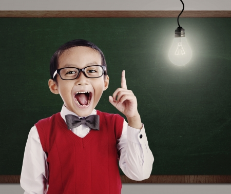 Asian genius student with light bulb shot in a classroom