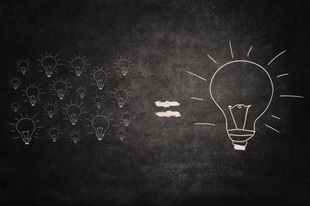 Picture of many small lightbulbs equal big lightbulb