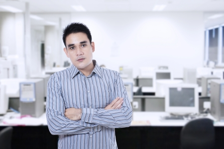Young asian businessman confident with arms crossed looking at camera