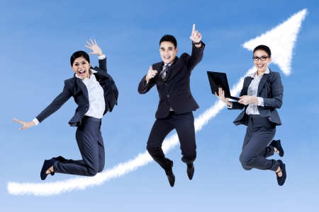 Group of business people jumping with notebook on the sky