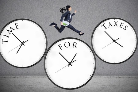 Concept of time for taxes with a businesswoman running on watch