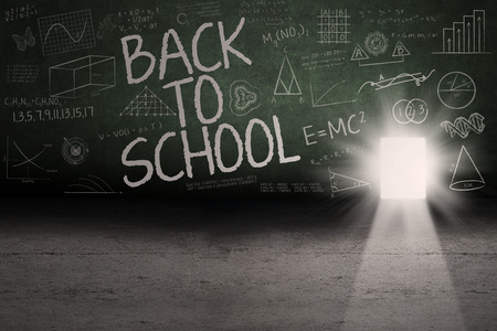 Back to school: Text of back to school on the blackboard with a door on the board