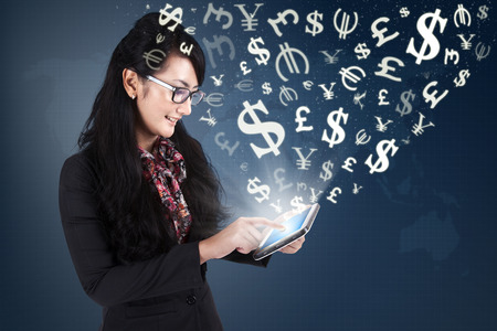 Image of successful female entrepreneur making money online with an internet connection and digital tablet
