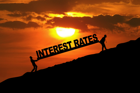 Photo for Silhouette of businessmen carrying Interest Rates word uphill - Royalty Free Image