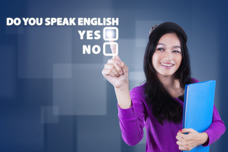 Image of beautiful teenage girl learn english speaking and touching a text of Do You Speak English?