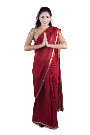 Photo for Full length of indian young woman wearing traditional clothes with greeting gesture, isolated on white background - Royalty Free Image