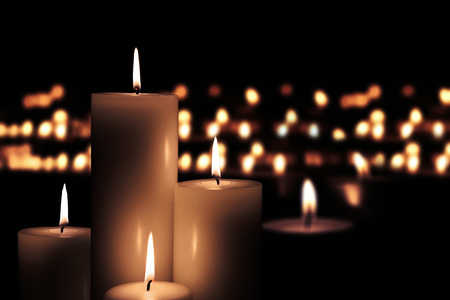 Picture of Easter candles burning at night with golden light of candle flame
