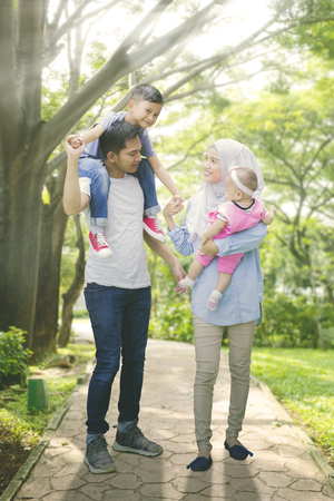 Photo for Medium shot of asian muslim family spending summer together - Royalty Free Image