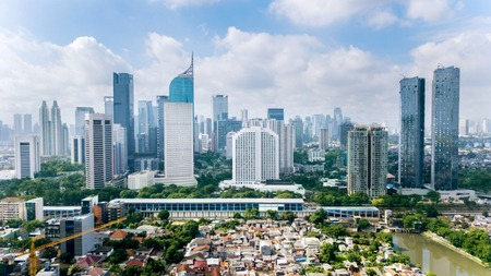 Photo pour JAKARTA - Indonesia. March 12, 2018: Panoramic view of Jakarta cityscape with residential houses, modern office and apartment buildings shot from a drone at sunny day - image libre de droit
