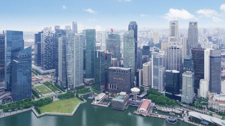 Photo for Beautiful aerial view of skyscrapers at waterfront. Shot at Marina Bay, Singapore - Royalty Free Image